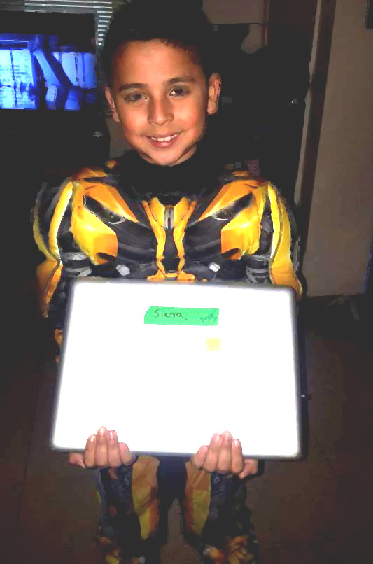 Josiah with his new MacBook, son of Antonio Lopez, murdered by SJSU PD in 2014
